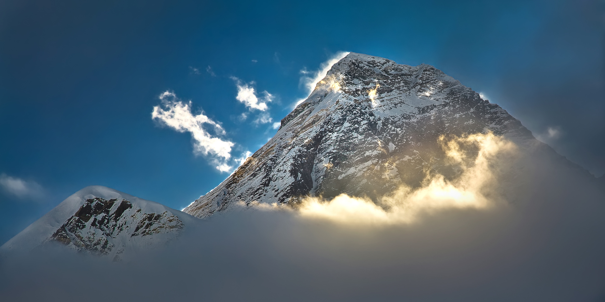 The peak of the highest mountain in the world - Mt. Everest in the light of the first sunrays.